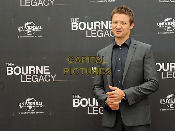 Jeremy Renner .'The Bourne Legacy' photocall, Rome, Italy..July 16th, 2012.half length grey gray suit jacket black shirt mouth open .CAP/IPP.©IPP/Capital Pictures.