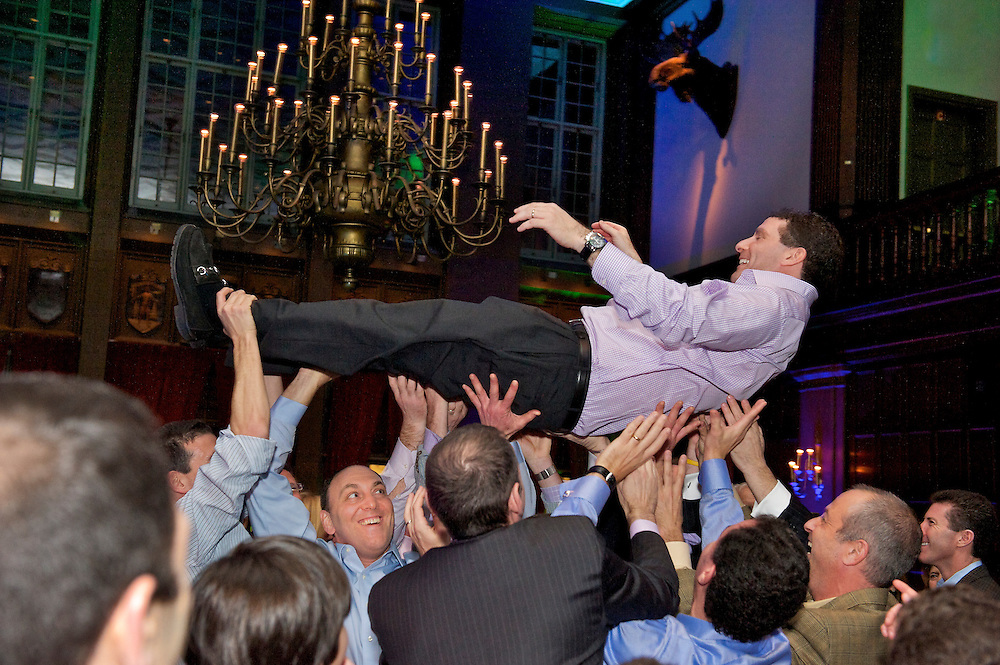 The Bar Mitzvah boy's dad being lifted in the air during the hora.