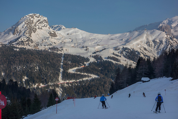 Skiers descending Col Rodella to Canazei, Dolomites, Italy.
