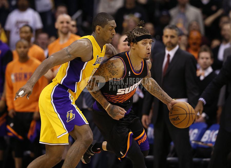 Jan. 30, 2013; Phoenix, AZ, USA: Los Angeles Lakers forward Metta World Peace (15) defends Phoenix Suns forward Michael Beasley at the US Airways Center. Mandatory Credit: Mark J. Rebilas-