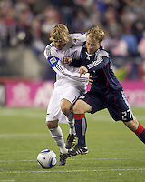 Second half substitute Kansas City Wizards defender Chance Myers (7) and New England Revolution defender Seth Sinovic (27) battle for loose ball. The New England Revolution defeated Kansas City Wizards, 1-0, at Gillette Stadium on October 16, 2010.