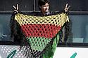 Iraq 2009 .An Iraqi supporter of the PKK holds up a shawl embroidered with the colors of the Kurdish flag..Irak 2009 .Une sympathisante du PKK avec un chale aux couleurs du drapeau kurde..