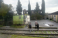 Men hang around the train tracks on the journey from Batumi to Tbilisi.