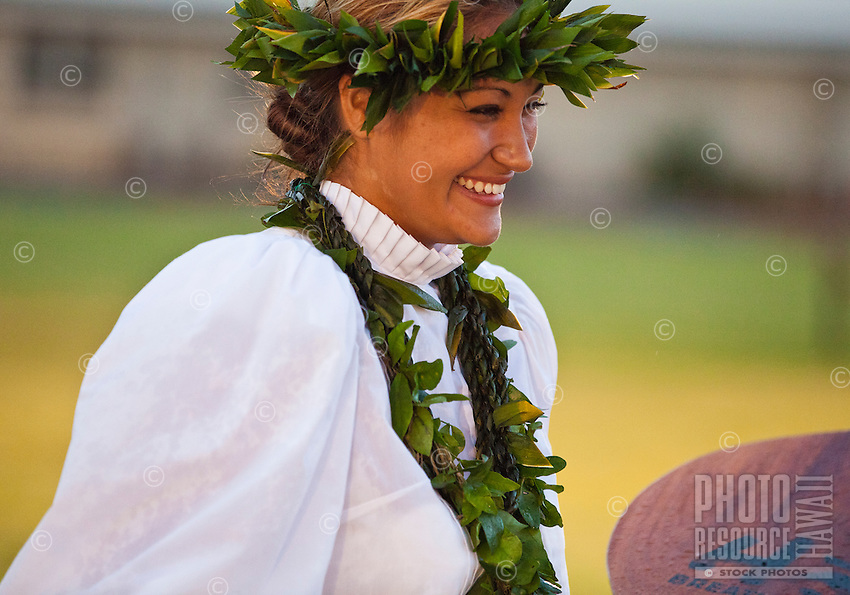 A woman of Halau Na Hula o Kaohikukapulani at the 2011 Kauai Polynesian Festival
