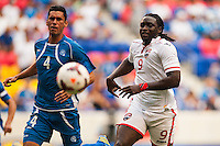 El Salvador defender Steven Purdy (4) and Trinidad and Tobago forward Kenwyne Jones (9). during a CONCACAF Gold Cup group B match at Red Bull Arena in Harrison, NJ, on July 8, 2013.