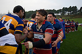 A jubilant Ardmore Marist Captain Tekori Luteru shakes hands with the Patumahoe players. CMRFU Counties Power 2008 Club rugby McNamara Cup Premier final between Ardmore Marist & Patumahoe played at Growers Stadium, Pukekohe on July 26th.  Ardmore Marist won 9 - 8.