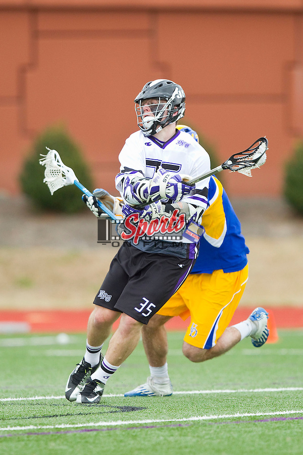 Michael Messenger (35) of the High Point Panthers winds up for a shot on goal against the Delaware Blue Hens at Vert Track, Soccer & Lacrosse Stadium on February 2, 2013 in High Point, North Carolina.  The Blue Hens defeated the Panthers 12-10.   (Brian Westerholt/Sports On Film)