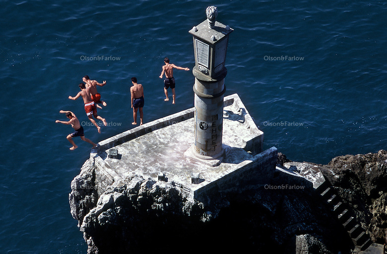Lighthouse and swimmers at the Black Sea town of Zonguldok