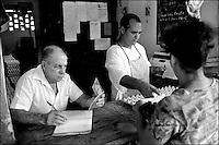 Cuba, Vinales.<br /> La &quot;libreta&quot; per le razioni di cibo in uno dei punti di distribuzione.<br /> Cuba, Vinales.<br /> Libreta de Abastecimiento (&quot;Supplies booklet&quot;), the system of food distribution.