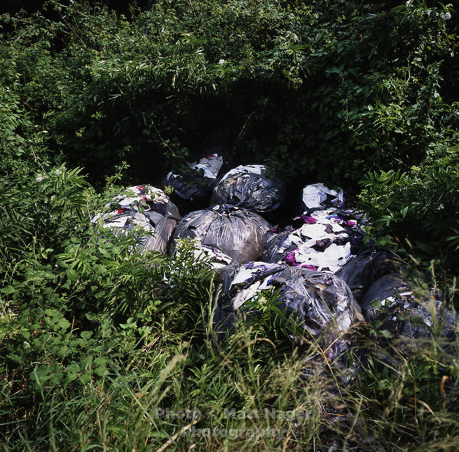 Piles of illegally disposed clothing scraps from a local tailoring company lies abandoned next to an irrigation canal for local farms near Marigliano, Italy. Piles of urban waste can be found throughout the provinces of Naples and Caserta. Surrounding farms have seen a drop in production quality of produce...PHOTOS/ MATT NAGER