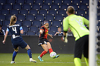 Kansas City, Kansas - Saturday April 16, 2016: FC Kansas City defender Becky Sauerbrunn (4) defends against Western New York Flash defender Jaelene Hinkle (15) in the first half at Children's Mercy Park.