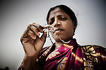 A christian refugee woman shows her crucifix pendant at YMCA relief committee in Orissa's capital Bhubaneswar on Nov. 04, 2008..During the clash, this woman lost everything and, only  in kandmahal disrtict,.more than 5000 houses were damaged.