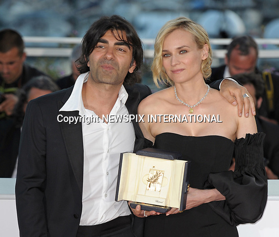 28.05.2017; Cannes, France: DIANE KRUGER AND FATIH AKIN<br /> Kruger won the Best Actress Award for her role in  &quot;In The Fade&quot;  by Fatih Akin, at the 70th Cannes Film Festival, Cannes<br /> Mandatory Credit Photo: &copy;NEWSPIX INTERNATIONAL<br /> <br /> IMMEDIATE CONFIRMATION OF USAGE REQUIRED:<br /> Newspix International, 31 Chinnery Hill, Bishop's Stortford, ENGLAND CM23 3PS<br /> Tel:+441279 324672  ; Fax: +441279656877<br /> Mobile:  07775681153<br /> e-mail: info@newspixinternational.co.uk<br /> Usage Implies Acceptance of Our Terms &amp; Conditions<br /> Please refer to usage terms. All Fees Payable To Newspix International