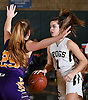 Leah Burden #1 of Carle Place, right, gets pressured by Catherine Kelly #25 of Oyster Bay during the Nassau County varsity girls basketball Class B final at SUNY Old Westbury on Thursday, Feb. 23, 2017. Burden scored 17 points in the Lady Frogs' victory.