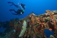 Couple (MR) exploring the Buoy 6 wreck, Palau, Micronesia.