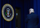 United States President Donald Trump leaves after speaking during a CEO town hall on the American business climate in the South Court Auditorium of the White House in Washington, DC, April 4, 2017.<br /> Credit: Olivier Douliery / Pool via CNP