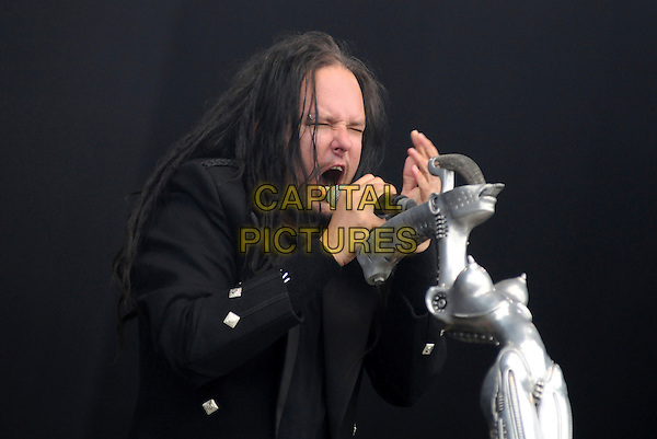 KORN - JONATHAN DAVIS .Download Festival 2009 - Day One,.Donington Park, Derbyshire, England,  UK, 12th June 2009..festival band gig on stage music live concert performing half length black microphone singing long hair jacket .CAP/BRC.©Ben Rector/Capital Pictures