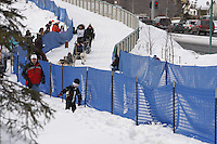 Saturday March 6 , 2010   Sam Deltour makes his way on the trail alongside Tudor road after crossing the Tudor Road bridge     during the ceremonial start of the 2010 Iditarod in Anchorage , Alaska