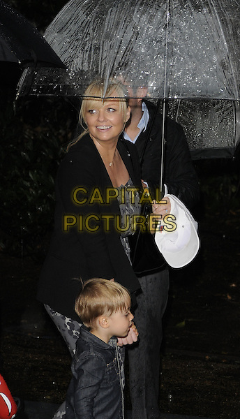 EMMA BUNTON & Beau .UK Premiere of 'Cars 2' at Whitehall Gardens, London, England..July 17th 2011.half length kid child mother mom mum umbrella side black jacket jeans denim .CAP/CAN.©Can Nguyen/Capital Pictures.