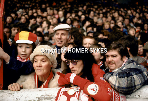 Family outing at the Kop Liverpool football fans 1980s wearing red.