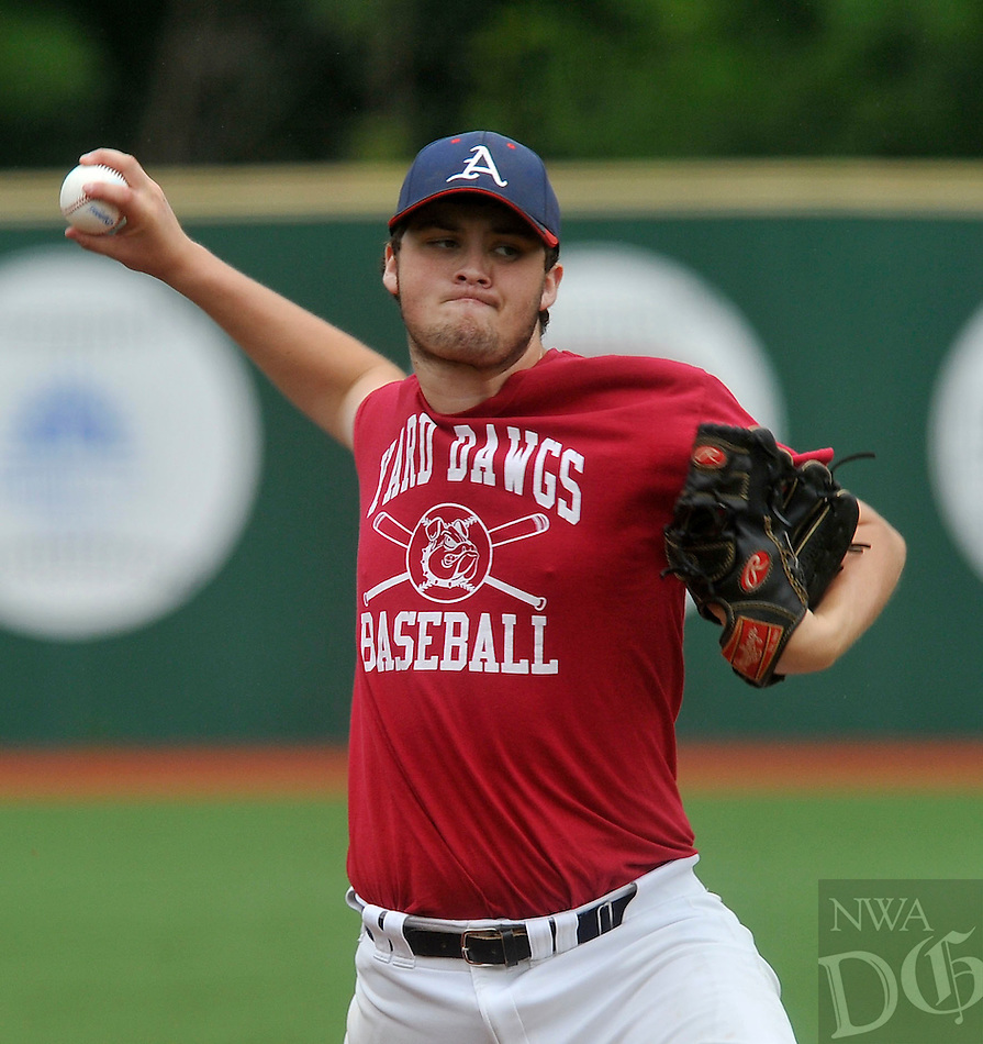 NWA Democrat-Gazette/MICHAEL WOODS --07/09/2015--w@NWAMICHAELW... Aarkansas Yard dawgs pitcher Preston Rosales fires a pitch during Thursday afternoons game against the Midwest Nationals in Fayetteville.