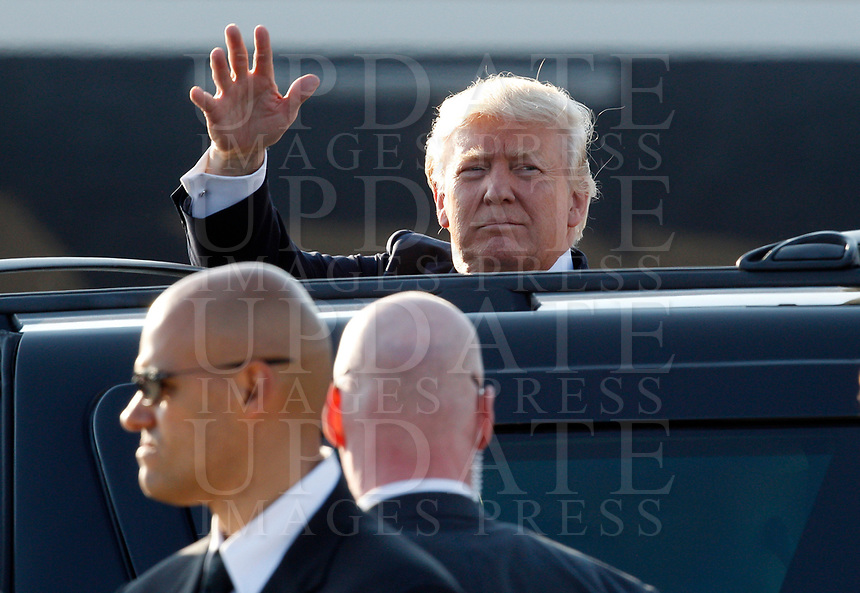 U.S. President Donald Trump waves to reporters after disembarking from Air Force One at Rome's Fiumicino international airport, May 23, 2017. Trump will meet Pope Francis, at the Vatican, and Italian President Sergio Mattarella, on May 24.<br /> UPDATE IMAGES PRESS/Riccardo De Luca