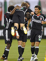 DC United midfielder Brian Carroll (16) celebrates with teammates Jaime Moreno (99),  Joshua Gros (17), and Clyde Simms (19) after scoring one of the goals of the game. DC United defeated the Columbus Crew 3-2, Saturday, July 15, 2006.
