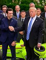 United States President Donald J. Trump, right, shakes hands with winning driver Simon Pagenaud, left, as he greets the 103rd Indianapolis 500 Champions: Team Penske, on the South Lawn of the White House in Washington, DC on Monday, June 10, 2019.  The President took some questions on trade, Mexico, and tariffs against China.<br /> CAP/MPI/RS<br /> ©RS/MPI/Capital Pictures