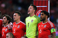 (L-R) Joe Allen, James Chester, Wayne Hennesey nd Ashley Williams of Wales sing the national anthem during the FIFA World Cup Qualifier Group D match between Wales and Republic of Ireland at The Cardiff City Stadium, Wales, UK. Monday 09 October 2017