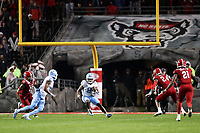 RALEIGH, NC - NOVEMBER 30: Michael Carter #8 of the University of North Carolina returns the opening kickoff during a game between North Carolina and North Carolina State at Carter-Finley Stadium on November 30, 2019 in Raleigh, North Carolina.