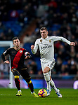Toni Kroos of Real Madrid (R) runs with the ball as Adrian Embarba Blazquez of Rayo Vallecano follows during the La Liga 2018-19 match between Real Madrid and Rayo Vallencano at Estadio Santiago Bernabeu on December 15 2018 in Madrid, Spain. Photo by Diego Souto / Power Sport Images