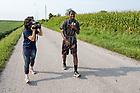 August 21, 2017; ND Trail day 8: ND Trail pilgrim JesusIsLord Nwadiuko is interviewed as he walks by WNDU TV reporter Maria Catanzarite. (Photo by Matt Cashore/University of Notre Dame)