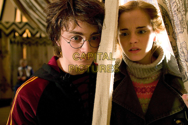DANIEL RADCLIFFE & EMMA WATSON .in Harry Potter and the Goblet of Fire.*Editorial Use Only*.www.capitalpictures.com.sales@capitalpictures.com.Supplied by Capital Pictures.