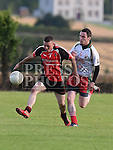 Sean McDermotts Kevin McMahon St Kevins Darren McMullen. Photo:Colin Bell/pressphotos.ie