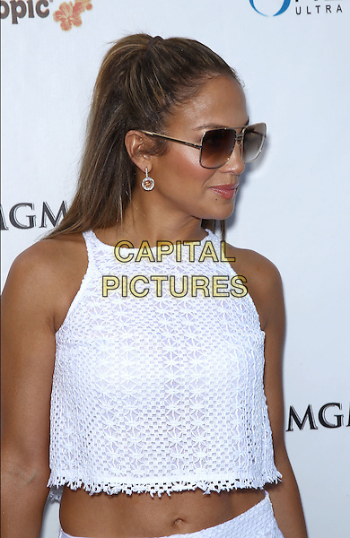 Jennifer Lopez.Jennifer Lopez celebrates her world tour with a special appearance at Wet Republic at The MGM Grand Casino Resort, Las Vegas, Nevada, USA, .18th August 2012..white half white crop cropped top sunglasses crochet sleeveless  stomach midriff tummy hair up ponytail sunglasses earring .CAP/ADM/MJT.© MJT/AdMedia/Capital Pictures.