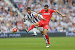 Kevin Stewart of Liverpool competes with Tyler Roberts of West Bromwich Albion during the Barclays Premier League match at The Hawthorns.  Photo credit should read: Malcolm Couzens/Sportimage