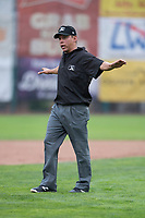 Field umpire Rene Gallegos calls a runner safe at third base during a Pioneer League game between the Billings Mustangs and Ogden Raptors at Lindquist Field on August 17, 2018 in Ogden, Utah. The Billings Mustangs defeated the Ogden Raptors by a score of 6-3. (Zachary Lucy/Four Seam Images)