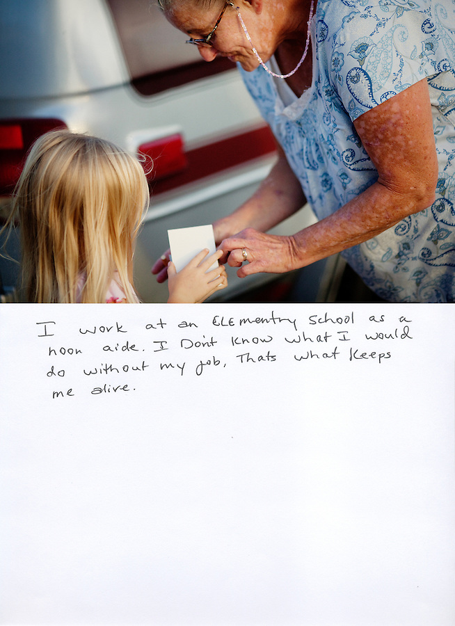"""This is a scan of a print that was given to the subject, Robin Ferguson, so that she could write her thoughts. She wrote:..""""I work at an elementary school as a noon aide. I Don't [sic] know what I would do without my job. That's what keeps me alive.""""..Ventura, California, August 3, 2010 - Robin Ferguson, right, opens a card for her granddaughter, Katie Eldridge, 5, outside of her van, where she has called home for the last year.  Ms. Ferguson lived in a home with her 2 sons, daughter-in-law and newborn granddaughter up until 2007, when she and one of her sons lost their jobs. They were unable to keep up with the rent and were forced to move to the back patio of her parent's home. Last year she says a neighbor called the City's code enforcement who gave her seven hours to move everything out. She moved into her van where she has lived since. Ms. Ferguson has a job - she works as a noon aide at Will Rogers Elementary - but she says she does not make enough to rent a home or apartment. Just this month, after three years of waiting, she was finally approved for low income housing assistance. She says that she is so happy that she will be off of the streets. """"I am grateful - just being able to feel like a complete person, self sufficient, not having to depend on some else to have a safe place to be."""" .."""