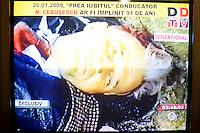 ROMANIA / Bucharest / 26.01.09..A television screen shot of a dead Romanian Communist dictator Nicolae Ceausescu moments after he was executed by firing squad on Christmas day 1989 during the Romanian Revolution. Romanian television replayed the trial and a documentary about his rule of Romania on the occasion of his birthday, 26 January. Ceausescu would have been 91 years-old in 2009. Romania experienced the most oppressive of the former Eastern Bloc's Communist regimes and by the late 1980s shops were empty of food, the imfamous secret police called the Securitate had created a police state and Ceausescu had launched grandisose Communist building projects modeled after North Korea that involved leveling one fifth of historic Bucharest...© Davin Ellicson / Anzenberger