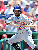 New York Mets second baseman Willie Harris (22) bunts for a base hit in the first inning against the Washington Nationals at Nationals Park in Washington, D.C. on Sunday, July 31, 2011.  .Credit: Ron Sachs / CNP.(RESTRICTION: NO New York or New Jersey Newspapers or newspapers within a 75 mile radius of New York City)