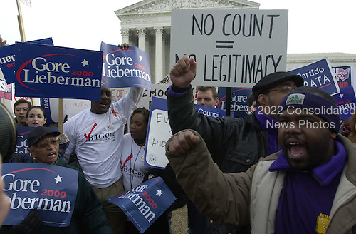 Supporters of the Democratic Party nominee for President of the United States, US Vice President Al Gore in front of the United States Supreme Court in Washington, DC on December 11, 2000.<br /> Credit: Ron Sachs - CNP