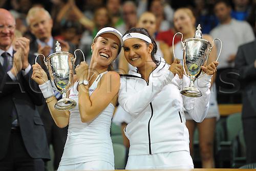 11.07.2015. Wimbledon, England. The Wimbledon Tennis Championships. Ladies Doubles Final between Martina Hingis (SUI) and Sania Mirza (IND) celebrate their win versus Ekaterina Makarova (RUS) and Elena Vesnina (RUS).
