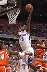 7 April 2003: Kansas guard Keith Langford (5) penetrates the Syracuse defense on his way to the basket during the Men's Division I Final Four Championships held at the Louisiana Superdome in New Orleans, LA. Syracuse University went on to defeat Kansas University 81-78 for the championship title. Photo by: Ryan McKee/NCAA Photos