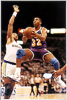 Basketball great Magic Johnson puts up two easy points against the Golden State Warriors at the Oakland Coliseum in 1992. (Alan Greth)