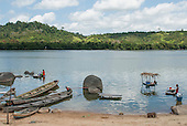 Xingu River, Para State, Brazil. Ilha da Fazenda caboclo settlement. Boats and women washing clothes in the river.