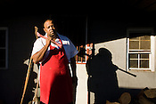 Melvin Simmons is the pit master at the Backyard BBQ Pit in Durham, where they smoke their BBQ with hickory and oak wood.