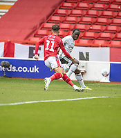 7th July 2020; City Ground, Nottinghamshire, Midlands, England; English Championship Football, Nottingham Forest versus Fulham; Neeskens Kebano of Fulham is tracked by Matty Cash of Notts Forest