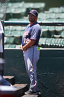 GCL Twins manager Ramon Borrego (12) in the dugout during a game against the GCL Orioles on August 11, 2016 at the Ed Smith Stadium in Sarasota, Florida.  GCL Twins defeated GCL Orioles 4-3.  (Mike Janes/Four Seam Images)