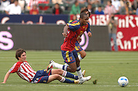 Real Salt Lake's Ryan Johnson keeps the ball away from  CD Chivas Sacha Kljestan in the second half at the Home Depot Center in Carson, CA on Saturday night, April 2, 2006..(Matt A. Brown/ISI)