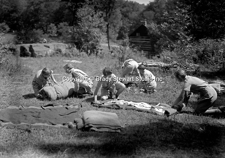 East McKeesport PA:  Girl Scouts rolling up their sleeping bags -  Camp Youghahela 1925